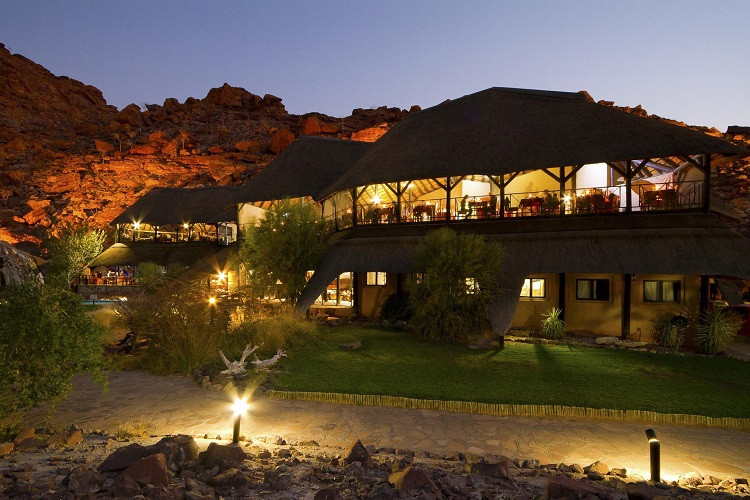 Twyfelfontein country lodge - external view of main area at night